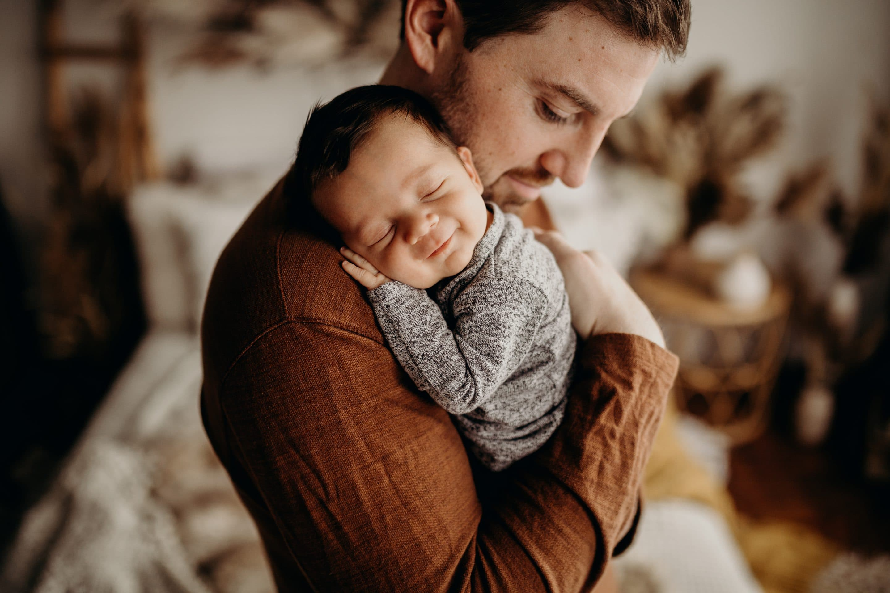 A father and his newborn shot by Jesse Salter
