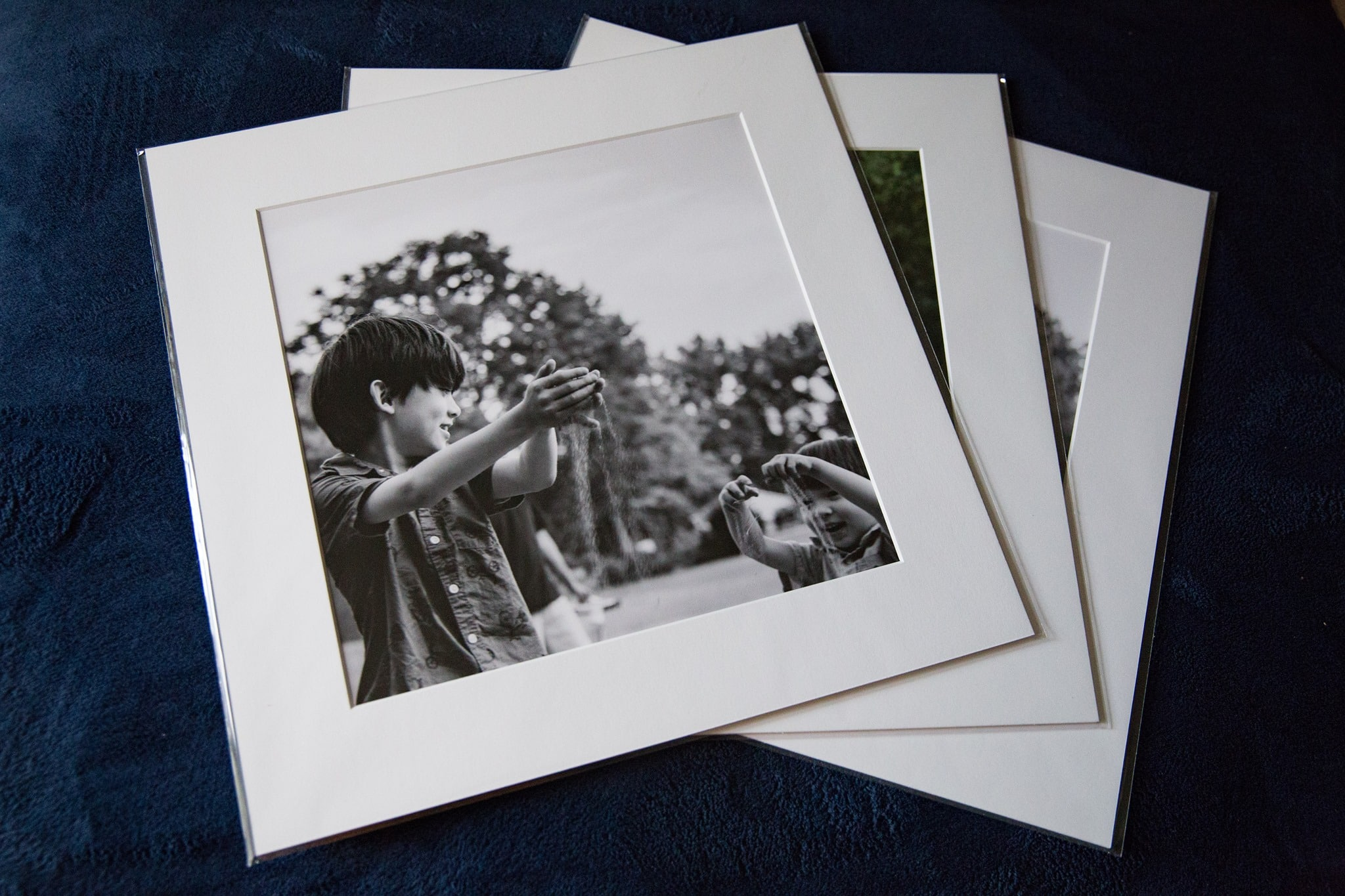 Black and white family photo prints being displayed
