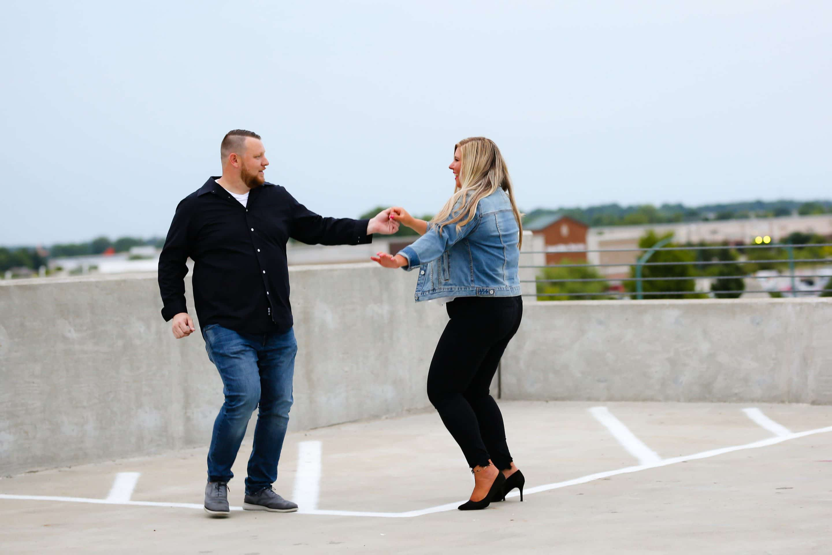 portrait of a couple dancing at a parking garage rooftop