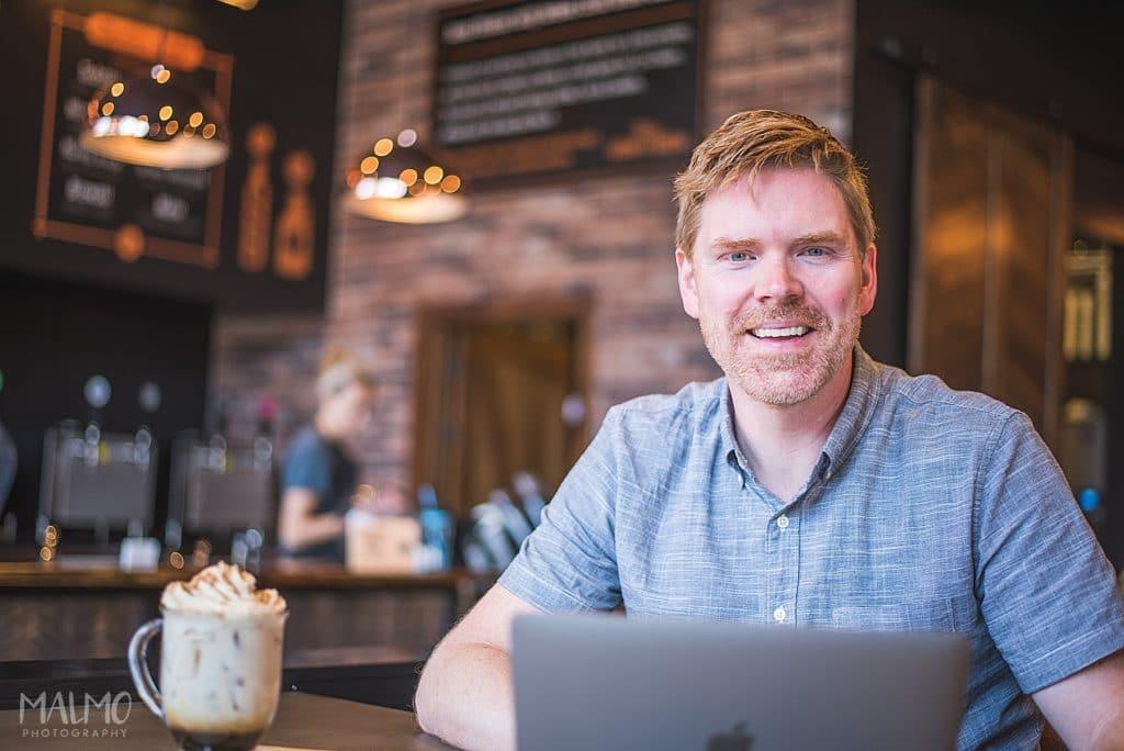 headshot of male inside a coffee shop