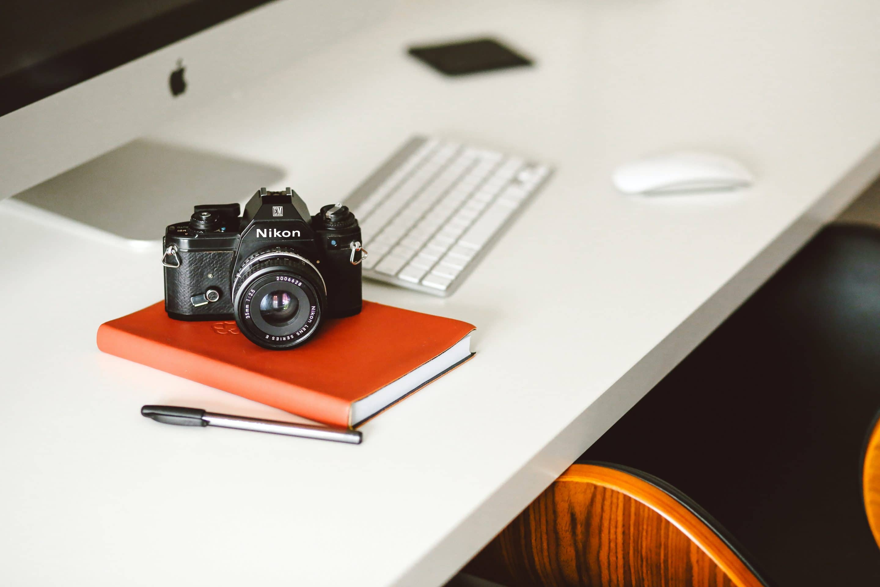an image of a camera and computer from unsplash
