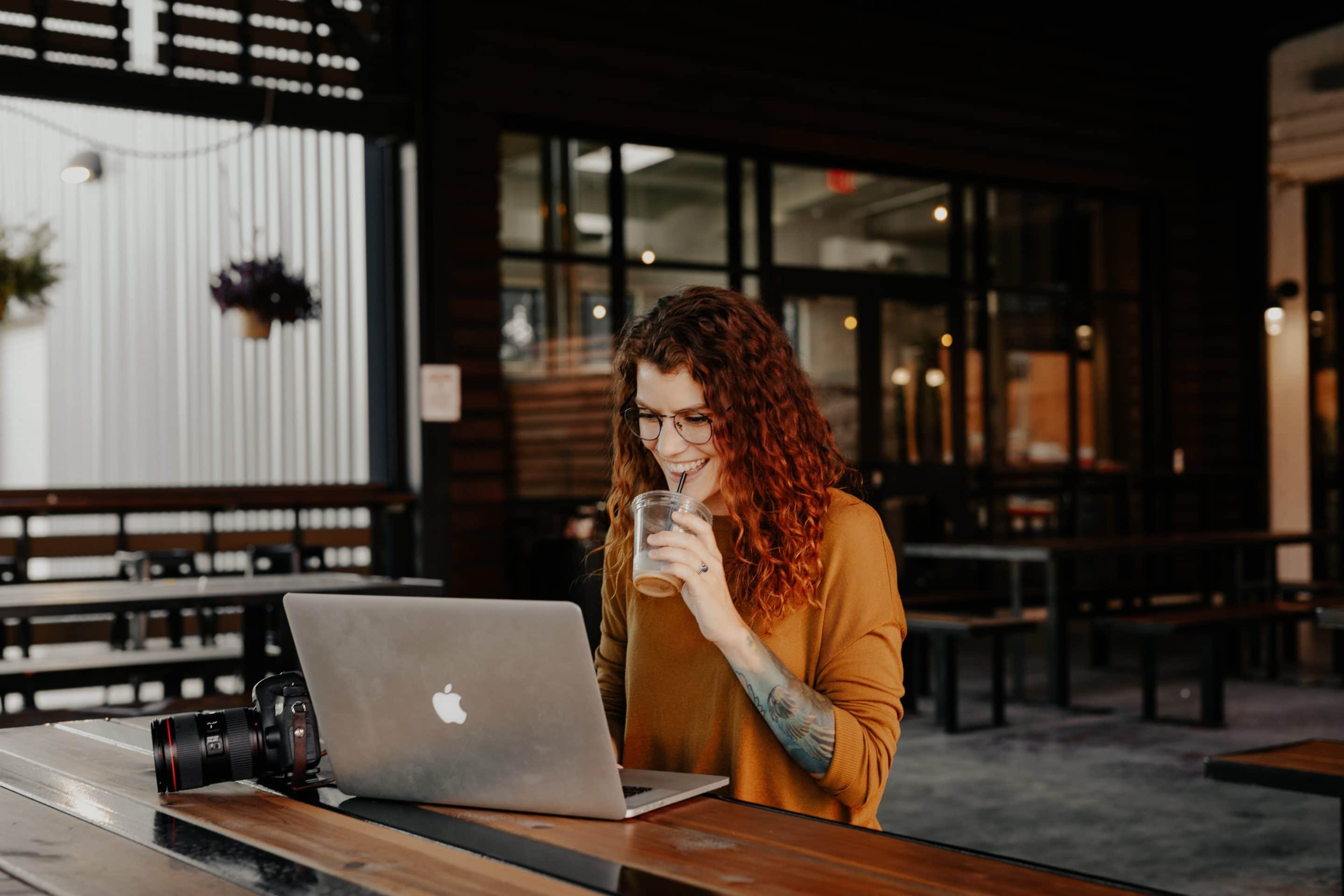 portrait of photographer with laptop from unsplash