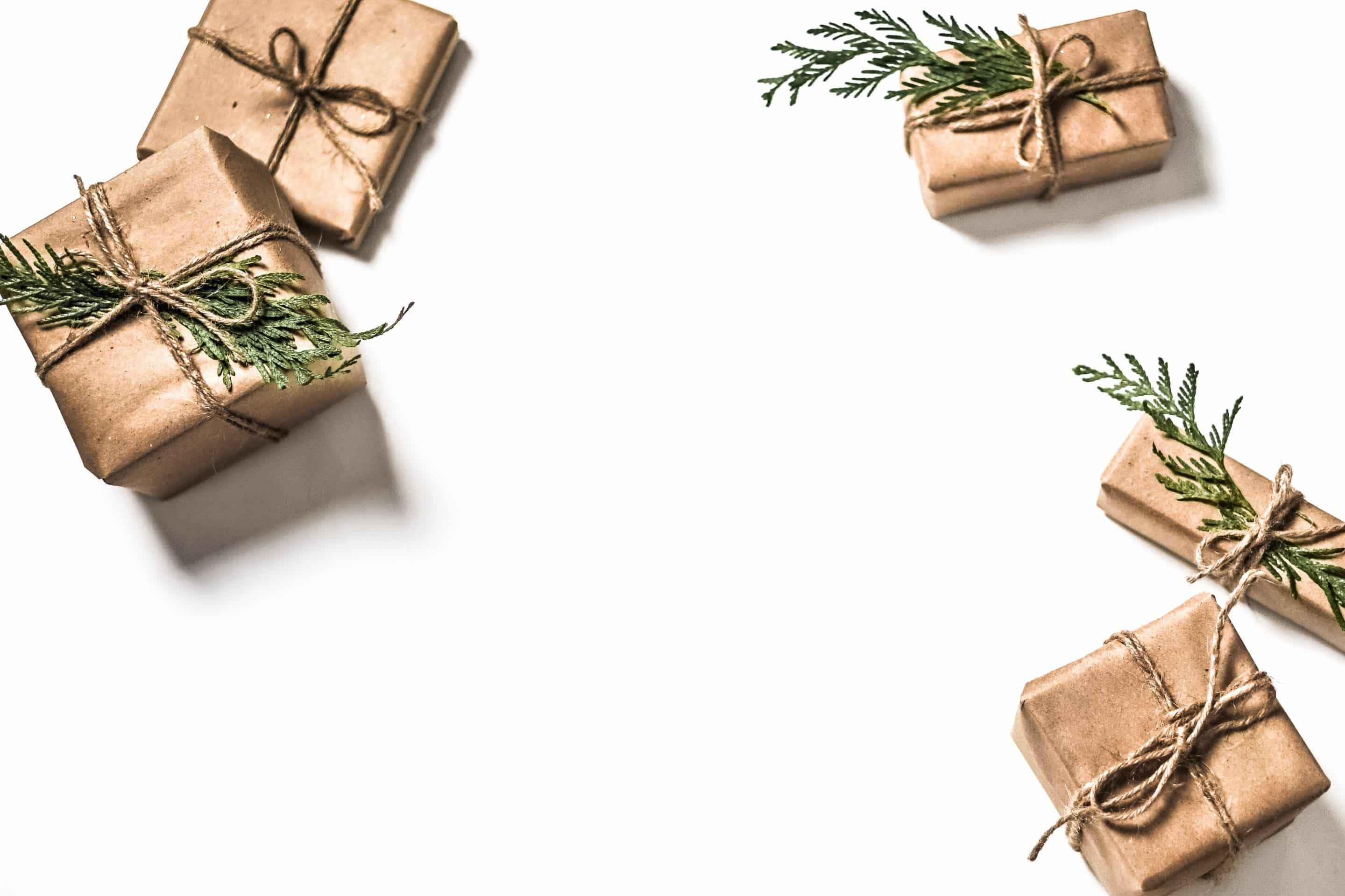 image of gifts wrapped in brown paper on white background from unsplash.com