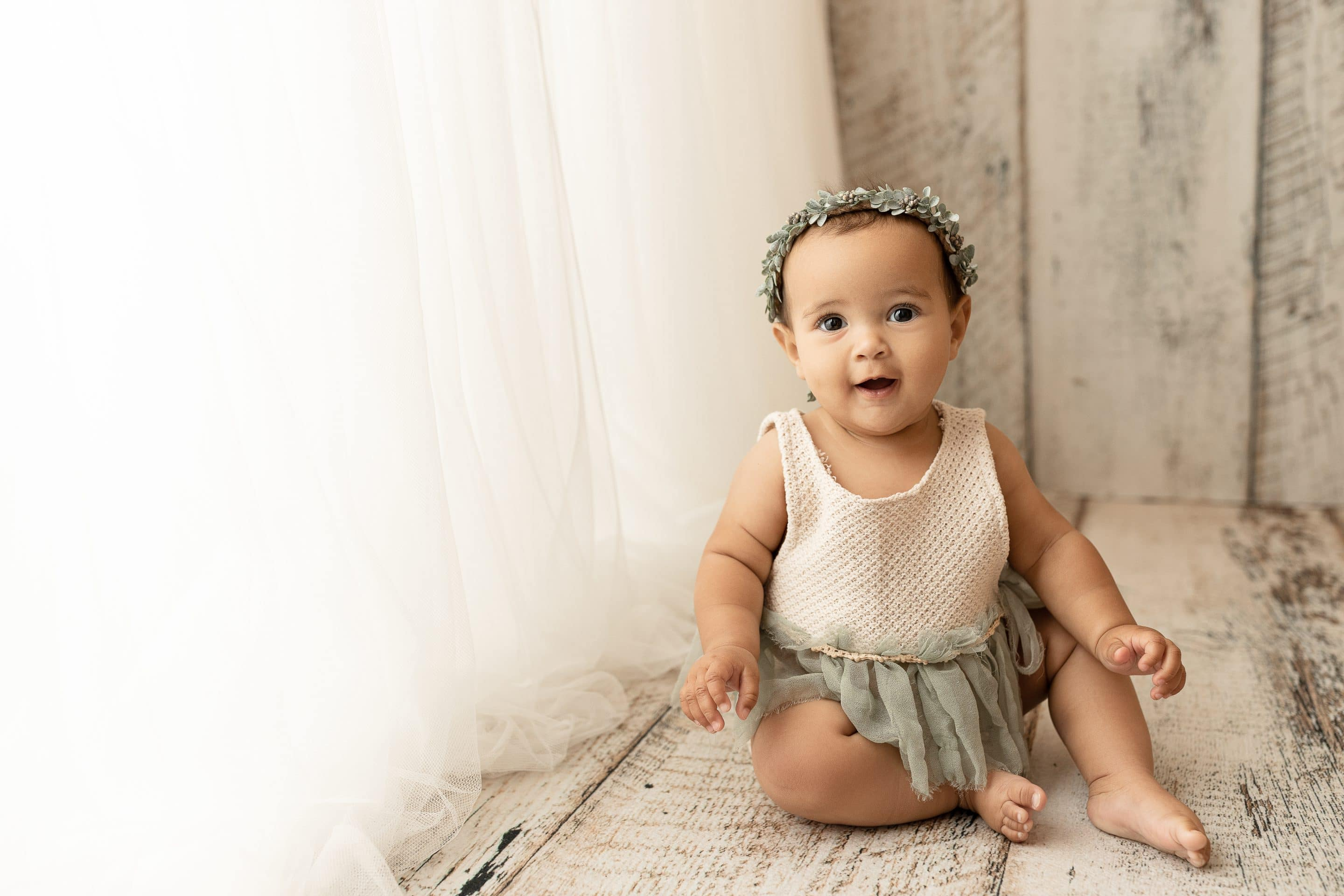 baby portrait with floral halo and boutique outfit