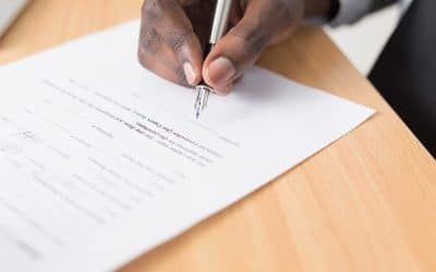Person signing a contract services agreement